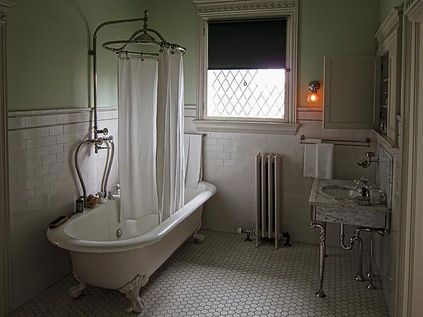 Victorian bathroom with amazing circular shower curtain over tub