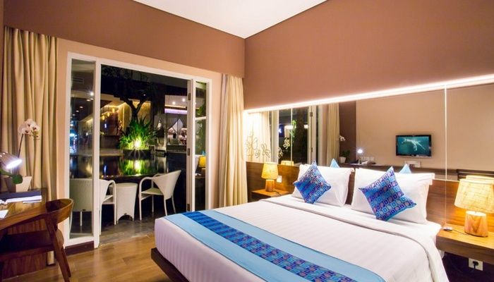 Grand Ixora Kuta Resort. 4 stars hotel with tropic style in Kuta, located near kuta beach, bali. It takes 15 minutes from the airport. Room facilities TV, mini bar, and wifi, equipped with a wood furniture and view to the pool. Hotel facilities spa, pool, restaurant. You can reach the discovery mall and waterboom 15 minutes by foot, and 10 minutes to Kuta beach. http://www.zocko.com/z/JGXK9