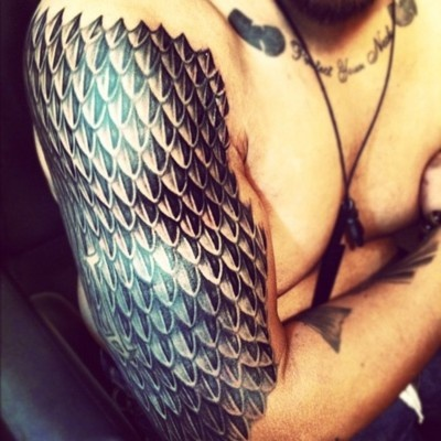 Dragon scales. Truly amazing tattoo (not something I'd get but definitely awesome...)