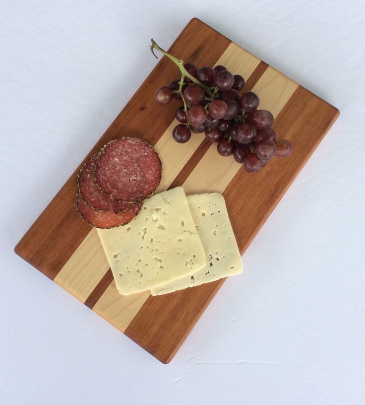 A personal favorite from my Etsy shop https://www.etsy.com/ca/listing/281655458/wood-cheese-board-bread-board-appetizer