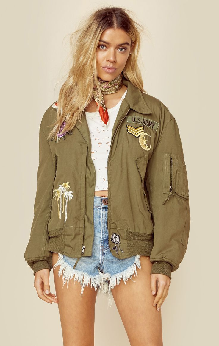 Planet Blue's exclusive new brand Good Fuckin' Vibes brings you the Bomb Squad vintage bomber jacket. Re modernized with embroidered patches, a vintage surplus army bomber jacket is given a fresh, m