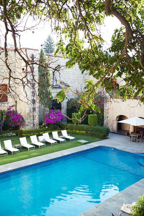 A quiet courtyard garden at La Quinta Real Oaxaca, originally the Convent of Santa Catalina de Siena, constructed in 1576.