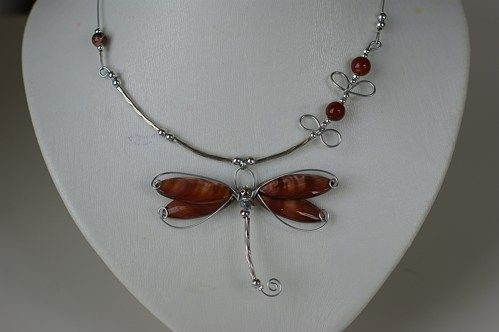 Here is an unique jewelry for dragonflies lover !  This dragonfly pendant if made with shell beads, metal tubes and metal wire .   Lenght : 16 to 18 inches   It's an original gfit for a women of any a