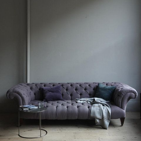 love this grey button tufted sofa