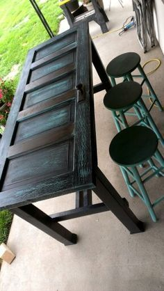 Old door bar table - like the look but would top with glass or resin. Drinking and uneven surfaces do not play well together