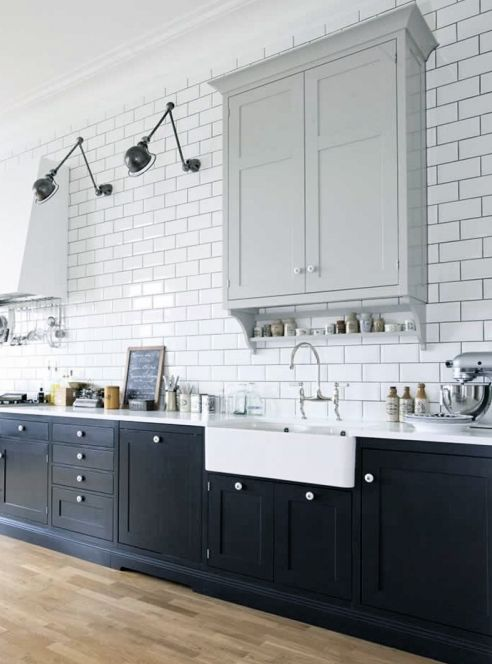 Kitchen + subway tiles + dark cabinets