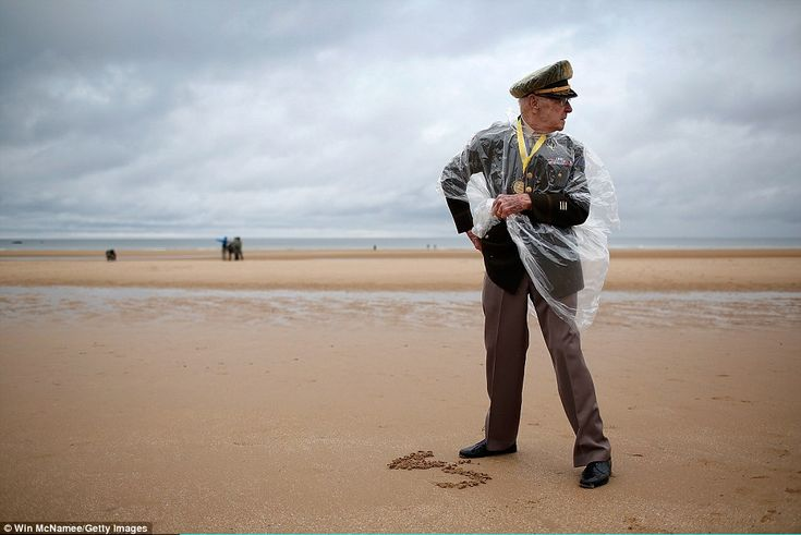 World War II veteran Charles Alford, from Waco, Texas, looks up Omaha Beach on June 4 wher...