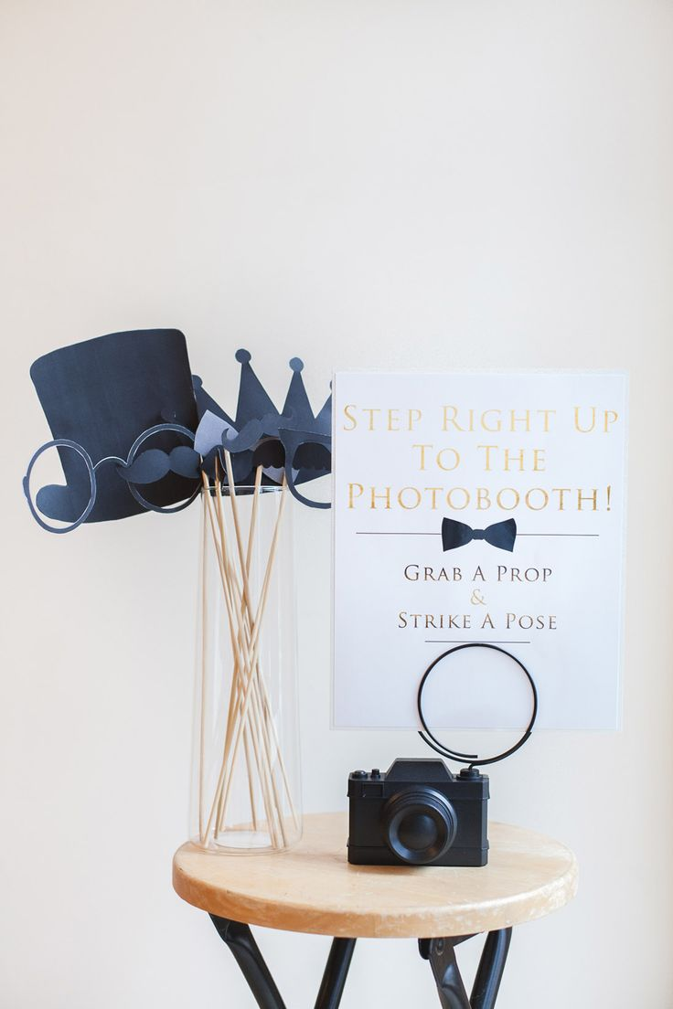 Brilliant photobooth sign and gorgeous black paper props. For a simple prop upgrade in flair, try taping the prop cut-outs on a black and white striped Susty straw!
