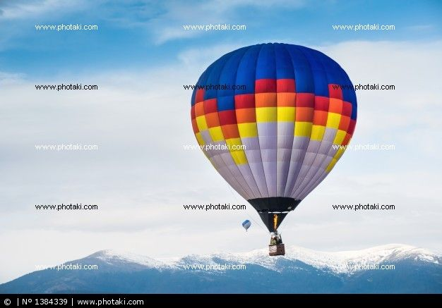 http://www.photaki.com/picture-multicolor-balloon-in-the-blue-sky_1384339.htm