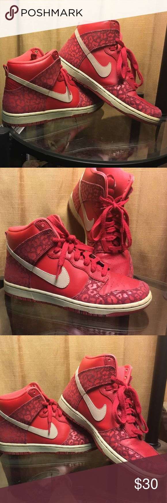 Nike shoes- red high tops for women - red high top Nike shoes for women . Sz 6. Have a bit of a cheetah print as shown in picture. They are in good condition. Nike Shoes Sneakers