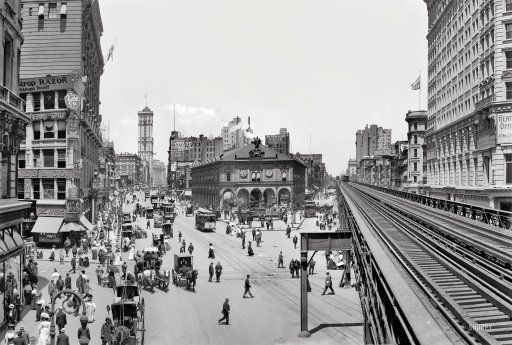 """New York circa 1908. """"Herald Square."""" Panorama composed of two 8x10 inch glass negatives, digitally merged, showing Broadway at 34th Street. Landmarks include the the New York Herald newspaper building (with its clockwork blacksmith bell-ringers and electrified owls), Sixth Avenue elevated tracks, New York Times building and Hotel Astor."""