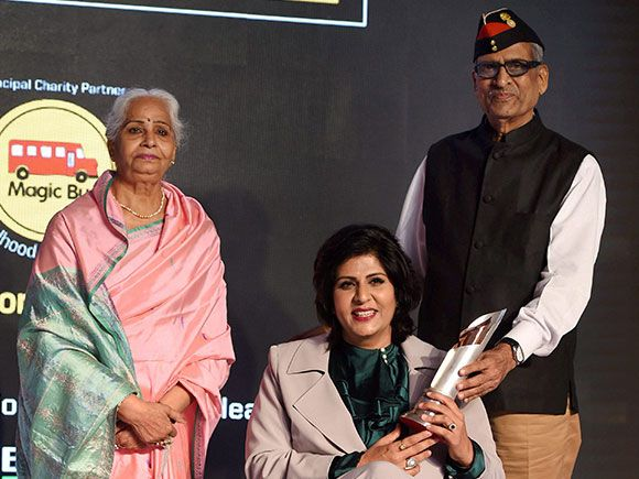 Indian Paralympic athlete Deepa Malik pose for a photo along with her parents