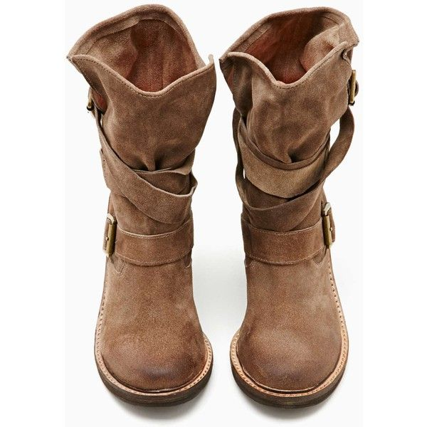 Perfectly distressed brown suede boots featuring split sides and wrapped straps with brass buckle closures. Chunky wooden heel, leather lining. Looks great pai…
