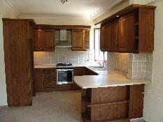 Muğla Bodrum da kestane ağacından yapılmış(masif) mutfak dolabı.