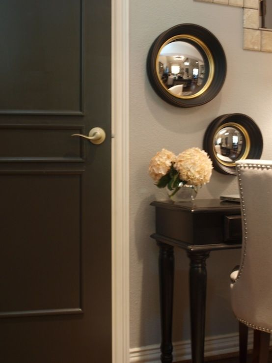 Chocolate brown doors (Benjamin Moore Dragon's Breath), white trim {The Creativity Exchange}
