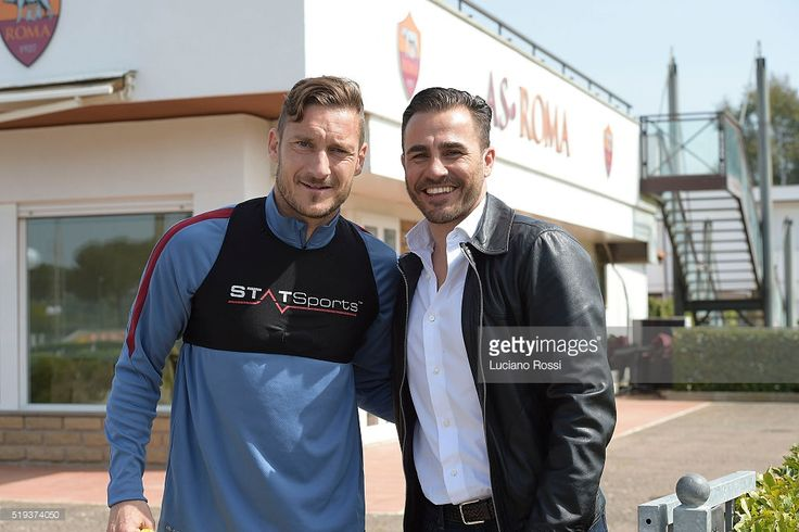 Former footballer Fabio Cannavaro (R) cheers Francesco Totti during an AS Roma training session on April 6, 2016 in Rome, Italy.