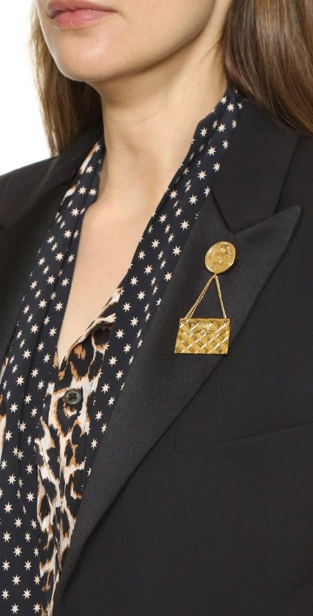 Chanel Flap Bag Pin (Previously Owned) via #shopbop #chanel #cc #bagpin A gold-tone, previously owned Chanel pin anchored by a logo disc and detailed with a hanging handbag charm.  Made in France. NOTE: Gentle wear should be expected and reinforces the history of this heritage piece.