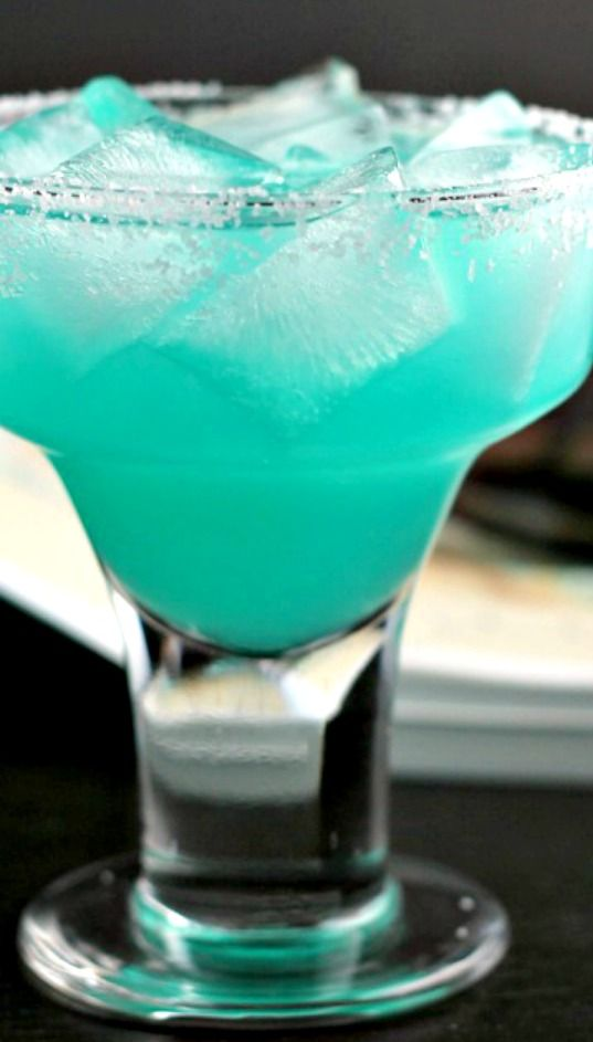 Blue Margarita Recipe ~ This bright blue margarita made with blue curacao liqueur will be a fun addition to any cocktail hour!
