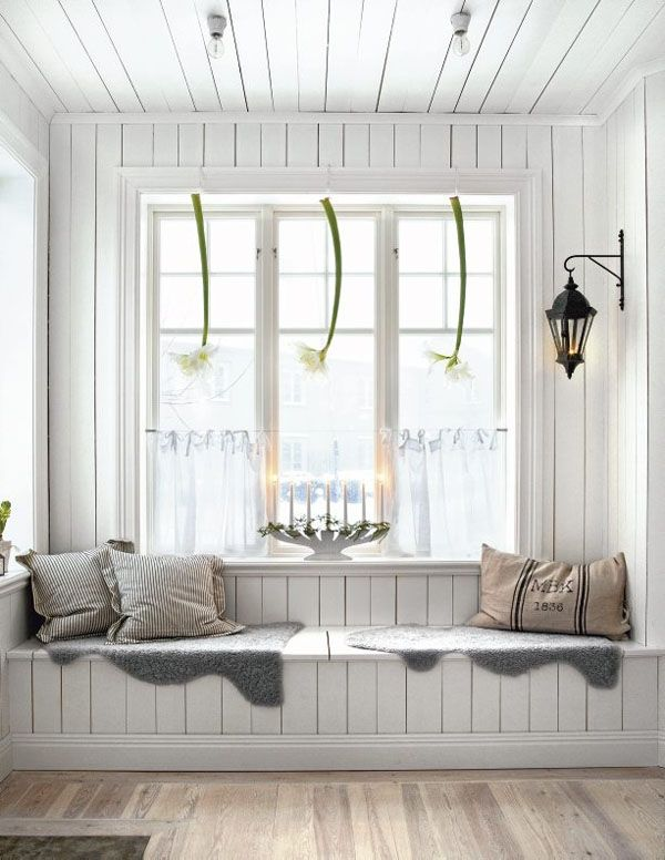 Scandinavian Decorating Ideas-- paperwhite lilies and a white ceramic candle holder dressed with greenery