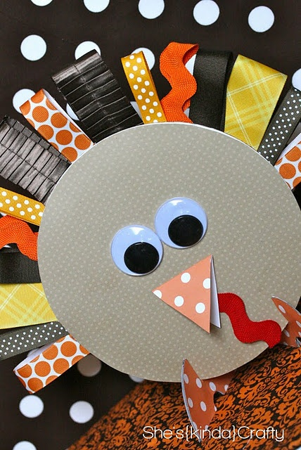 Turkey made out of ribbon loops (with a piece of floral wire to hold up) for feathers, googly eyes, scrapbook paper beak, and cardboard circle with cute paper to cover for body.