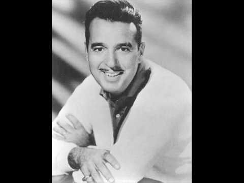 Sixteen Tons - Tennessee Ernie Ford. Oh this reminds me of floating trough the dancefloor in foxtrot steps//