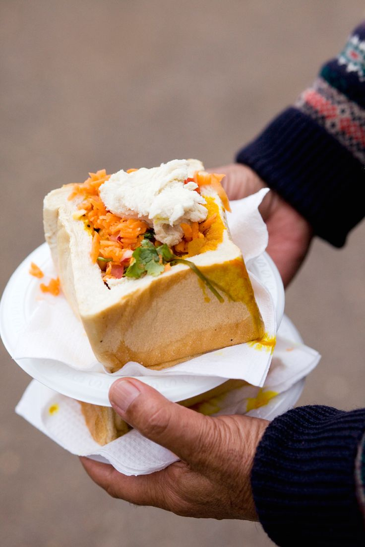 Bunny chow with bean curry and carrot salad