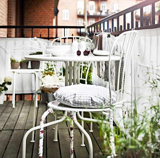I think this would work for drinks on the balcony - its not too big to take up all the space and by being white it will blend in