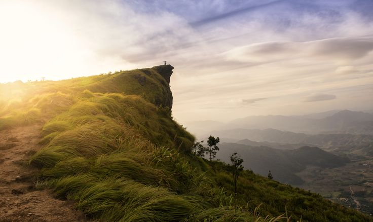 The Peak - Man on the peak of the mountain and cloudscape at Phu chi fa in Chiangrai,Thailand