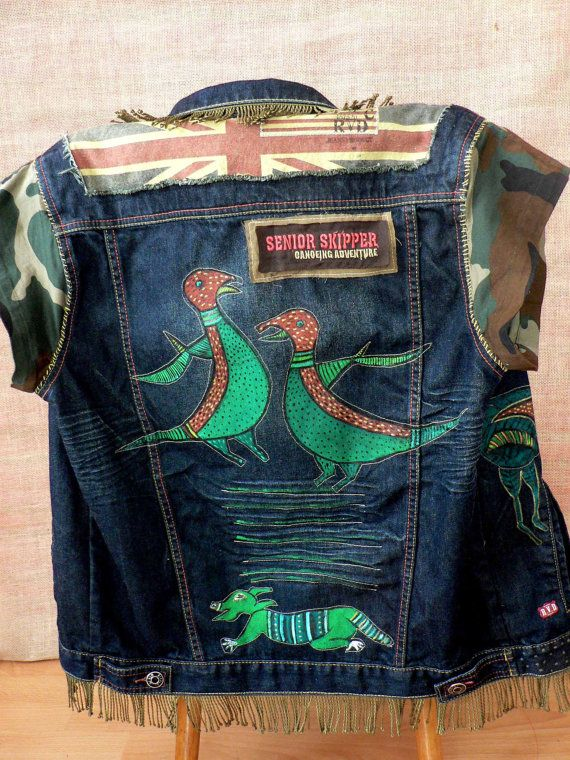 Animal art and hand painted recykled denim vest. One of a kind. Short moro sleeves. Collar and bottom of vest decorated with tassels. Buttons. Painted with animals inspired by South American Art. Length - 24,5 in/ 62 cm/ Width bust - 43 in/110 cm/ Width hips - 42 in/107 cm/