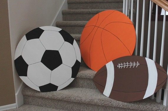 Extra large wooden sports balls. Hand painted and custom made. Unique sports room decor! Visit www.roomdoodles.com