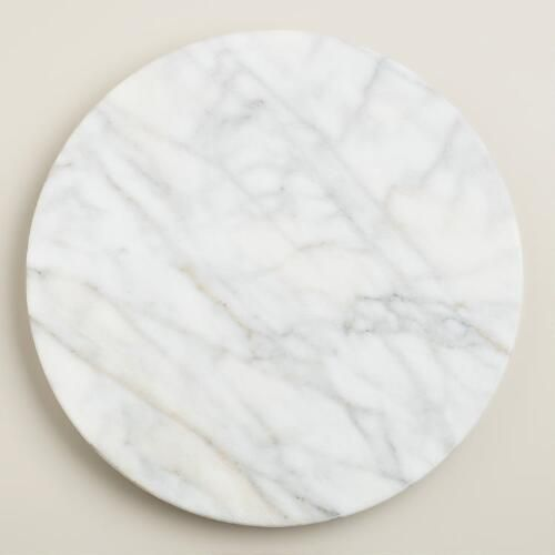$11 marble lazy suzan, good reviews http://www.worldmarket.com/product/white+marble+lazy++susan.do?page=2&from=fn