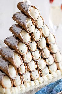These cannoli, which can be in a tower or in a giant cannoli shell. | 21 Beautiful Wedding Desserts That Are Better Than Traditional Cake