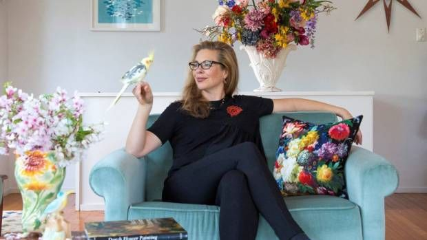 """At my place: Photographer Emma Bass' colourful home Photographer Emma Bass lives in a light-filled 1950s home in Mt Eden with her daughter Olive, son, George, and her muse, their pet bird Kowhai. Bass describes her home as """"sunny, colourful, eclectic"""" and said she preferred to spend her money on flowers ... #photographyjobsonline"""