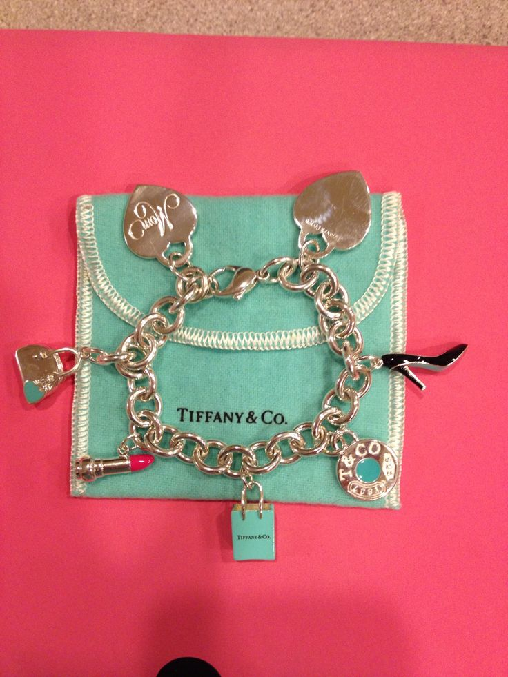 MY Tiffany's charm bracelet. (Charms were given to me by husband and children for Christmas, Mother's Day, etc.) Purchased from Tiffany and Co. at Fairfax Square/ Tyson's Corner Virgina.