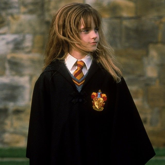 """""""I was so excited that me and my mum found this great purple denim dress, which I thought was so cool, and it had a little feather boa. And my mum found me these great purple lizard-skin heeled boots—not real lizard skin. It was so exciting."""" - Emma Watson on attending the first film premiere #HarryPotter"""