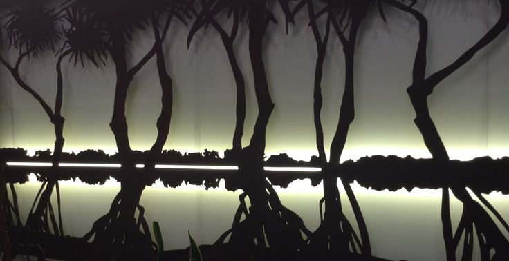 'Pandanus Wetland' laser cut wall art by Entanglements. Our strip lighting creates a subtle sunset effect at night.