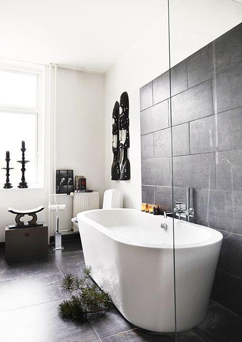 Fresh, modern monochrome bathroom! Dark tiles like this can be sourced from Mandarin Stone