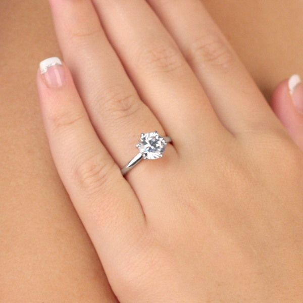 * do i like princess cut or this??!* Sonia's Signity CZ Engagement Ring - Round Cut. So simple