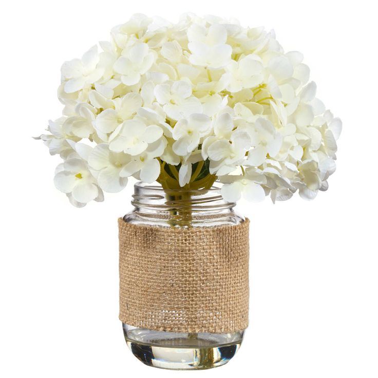 Inject a fresh touch of nature into your home with this pretty bunch of hydrangeas in a jar. Sure to brighten up any room, this greenery is a great way to add life to your space without all the work of keeping a real plant alive! Perfect for green thumbs and black thumbs, alike, this faux flora would look great on a nightstand, end table, mantle or console table as part of a stylish vignette or even on its own.