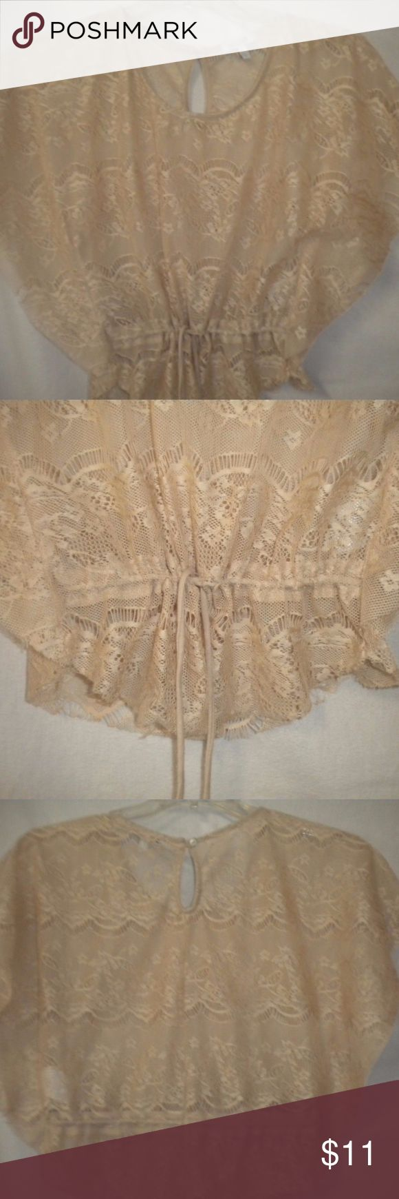 "Delia's Small Beige Lace Dolman Bat Wing Shirt Too Barely Worn. Delia's Junior Size Small Top. Layering. Batwing. Dolman.  Sheer.  Beige.  Lace.  Drawstring.  Made of 100% Polyester. Chest approx 36"". Length approx 22"". Delia's Tops"