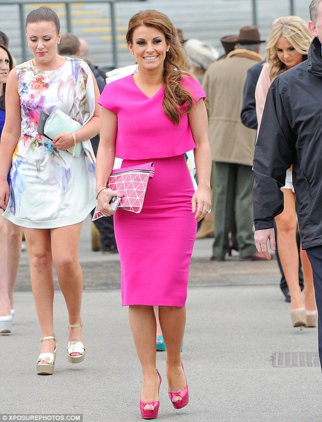 The fuchsia's bright: Coleen Rooney mixed up her style as she headed to Aintree Racecourse to celebrate both her 28th birthday and the first day of the 2014 Grand National on Thursday morning