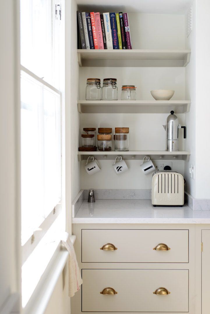Open shelves make the most of this narrow alcove, perfect for storing cookbooks and tea and coffee supplies