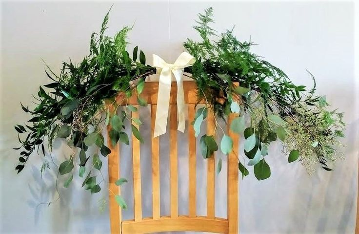 Flowey greenery for wedding design decoration.  Can be used to top of a seating plan chart, picture frame, door way, window, or other flat surface to add a final touch of beauty.  Italian ruscus, seeded eucalyptus, parvifolia, baby eucalyptus.