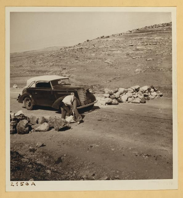 In 1938 Arabs set up this stone road block at Huwara on the West Bank. Same location of disturbances today. (Library of Congress)