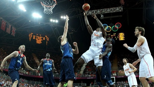 Serge Ibaka of Spain shoots against Joel Freeland of Great Britain. #Olympics Olympics.