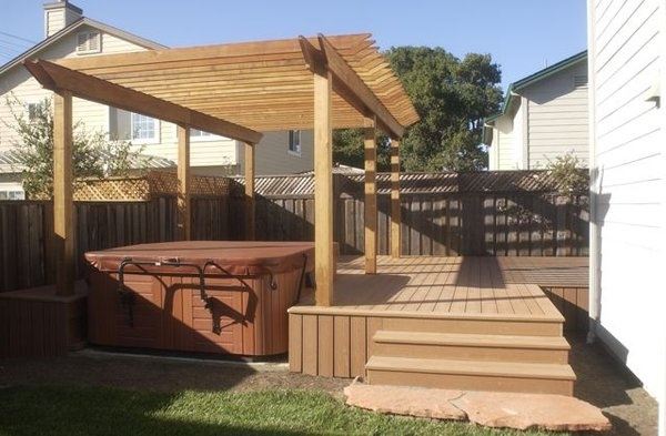 Composite Deck With Redwood Arbor Over A Hot Tub Garden