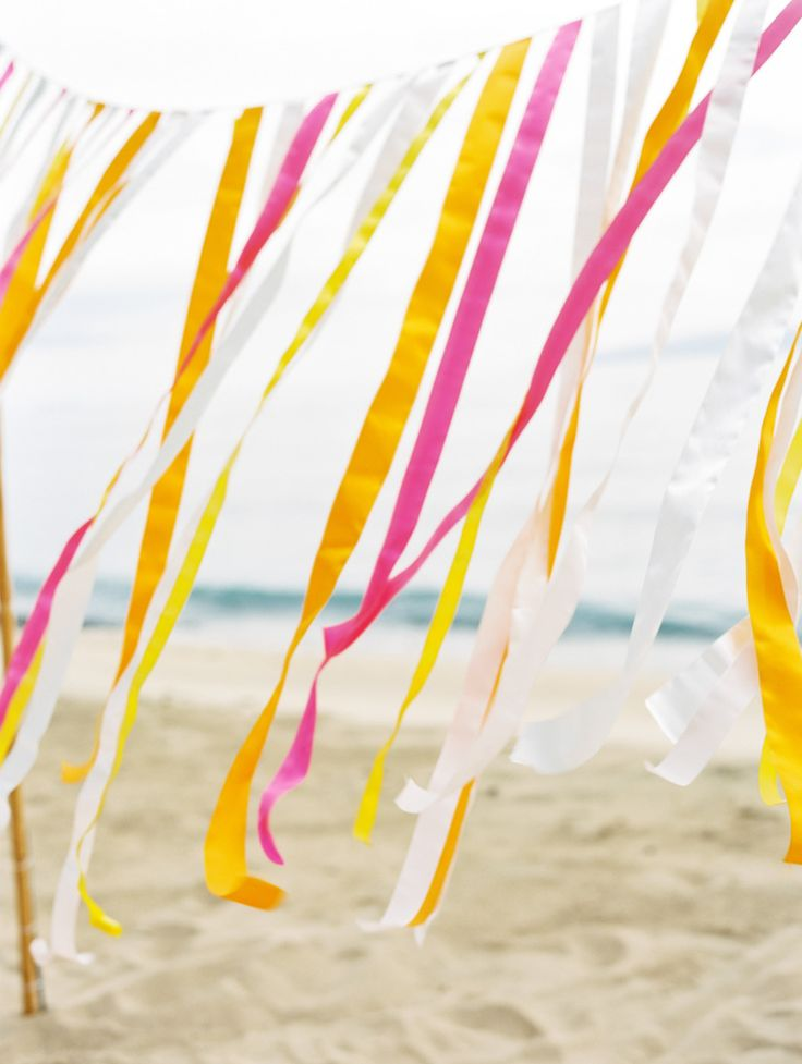 Bright Ribbons blowing in the beach wind!      See more wedding inspiration on #smp here -- http://www.StyleMePretty.com/destination-weddings/2014/05/13/hawaiian-beach-wedding-inspiration/ Photography: WendyLaurel.com