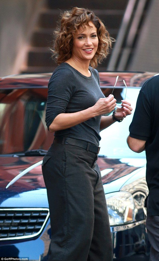 Hot cop: On Tuesday she was spotted rocking Detective Harlee Santos' curls as she filmed further scenes for her new cop show Shades Of Blue in New York