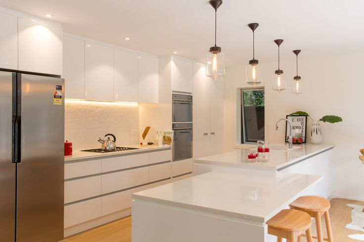 modern white kitchen by KMD Kitchens Auckland