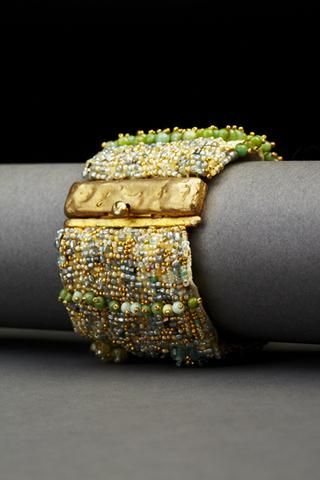 """Aqua Flora Couture Cuff Aquamarines, turquoise, vintage glass seed beads, green garnets and 14-carat yellow gold-plated beads, hand embroidered on heavy silk with a hammered, yellow gold-plated over sterling silver clasp.  Width: 1 3/4"""""""